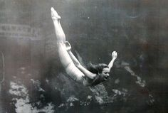 Photos from the albums of Ginger Stanley Hallowell show the early mermaids of Weeki Wachee springs. Ginger takes a dive.