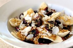 Unsweetened, natural Greek yogurt (or coconut cream) with cherries, banana, coconut flakes and toasted cashew nuts.