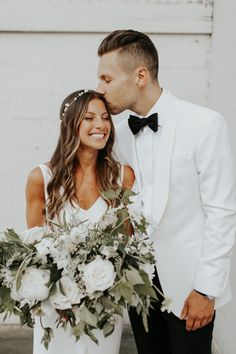 This white rose bridal bouquet is classic, elegant, and fresh | Image by Melissa Marshall #weddingphotoinspiration #weddingphotoideas #weddingportrait #couple #cutecouple #coupleportrait #weddingdress #bridalportrait #bridalstyle #bridalfashion #bridalinspo #bridalinspiration #groomstyle #groomportrait #groomattire #groomapparel #groominspo #groominspiration #bridalbouquet #bouquet