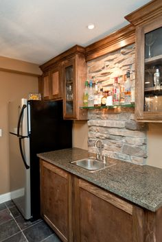 Wet bar with stone column and glass shelves