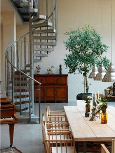 How fun would it be to have a small spiral staircase as a quick access, while a larger staircase was somewhere else??