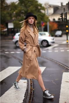 trench and sneakers