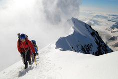 Weissmies     Climbers reach the summit of the Weissmies peak in Valais, Switzerland from the Saas Almagell side. Valais, Switzerland