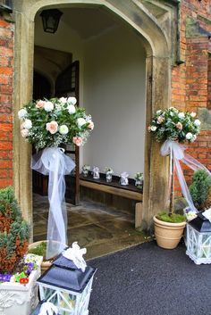Classically Elegant Spring Wedding at St Cuthbert's Church; Two Bay Trees framed the front door