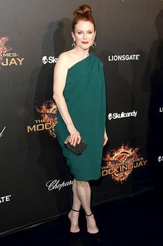 Julianne Moore swept up her red hair into a top knot, and wears a green one-shouldered dress by Lanvin at The Hunger Games party at Cannes