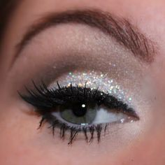 Glamorous cut crease with silver glittery lids.  Great look for a  night out at prom!