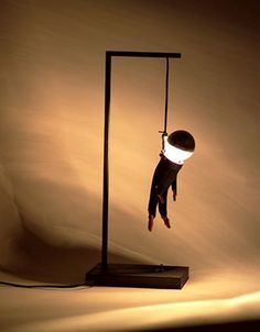 A modern lamp design combining a morbid hanging man with lighting concept. It may be a bit morbid to hang a man for light, but this is also creative and imaginative light design. Cool Lighting, Lighting Design, Usb Lamp, Unique Lamps, Unique Art, Picture Design, Light Decorations, Lamp Light, Light Bulb