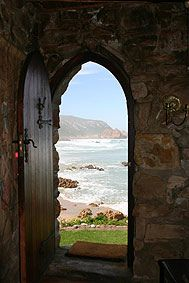 A photo I took looking out of the castle door at Noetzie Beach in Knysna, South Africa where we lived Knock and it shall be Opened.