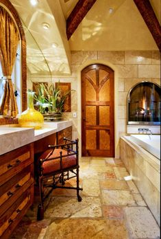 fireplace blends into the warmth of the bathroom and adds to the color scheme
