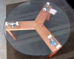 giant lazy susan table made with skateboard trucks and wheels