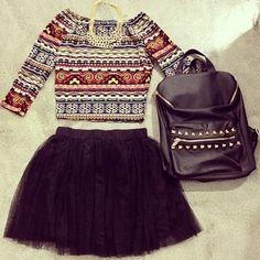 Black mini skirt with 3/4 length Aztec crop top.