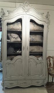 Love that they've re-purposed this china cabinet to hold linens.