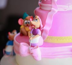 Cinderella cake with sugar figures! The flying birds and mice are making Cinderella's cake in my version. It mimics the dress the mice are making her in the movie. The birds defy gravity in this one....