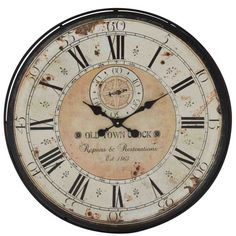 The vintage influence seen in the wall clock will appeal to all those who love antique design. The clock features a black metal frame that wraps around the aged roman numeral face. Colors of green and tan are seen in the round clock face. Rustic Wall Clocks, Rustic Walls, Wooden Clock, Metal Clock, Old Town Clock, Clock Repair, Clock Decor, Wall Decor, Clock Art