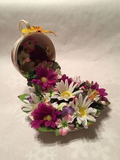Cup and saucer, floating teacup, purple and white floral arrangement