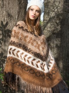 Would you know if her arms were bound behind her under that gorgeous long poncho..?