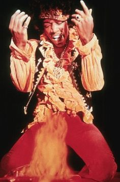 """Author Michael Heatley wrote: """"The iconic image by Ed Caraeff of Hendrix summoning the flames higher with his fingers will forever conjure up memories of Monterey for those who were there and the majority of us who weren't. Easy Guitar, Guitar Tips, Jimi Hendrix, Man Kneeling, Sunshine Of Your Love, Monterey Pop Festival, Guitar For Beginners, Could Play, Types Of Music"""