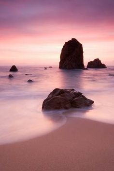 PINK GLOW    Sunset was disappointing, but ten minutes later a vibrant pink glow formed in the sky to add a nice touch to this evening beach scene. This photograph was taken at the Sintra Cascais Natural Park, Portugal.    Photography by Pedro Bento.