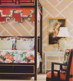 graphic wallpaper in neutral, floral bedspread, canopy bed, desk as bedside