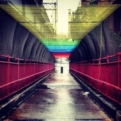 The Williamsburg Bridge in rainbow yarnbomb.