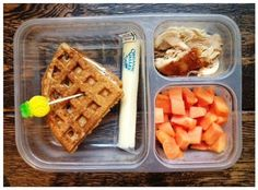 waffle sandwich with cream cheese, fruit, cheese string, shredded chicken.
