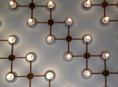 Copper pipes with incandescent bulbs - very cool. I would try using the plumens bulbs...