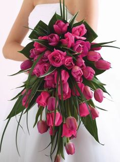 Magenta pink tulip and roses massive teardrop bridal wedding bouquet #magentapinkbridalbouquet