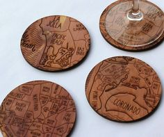 Set of 4 wooden coasters. Each coaster has one neighborhood side, each cropped into 4 different neighborhoods.