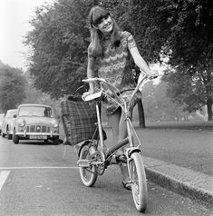 1960s fashion photo. Those Raleigh folding bikes are still bought, sold and ridden.