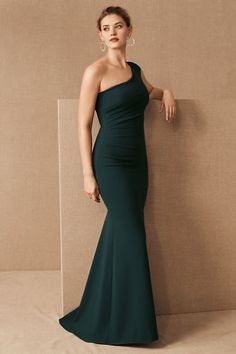 A one-shoulder silhouette gives this figure-flattering dress a sense of modernity, while a flared skirt adds a touch of romance.Only available at BHLDN Forest Green Bridesmaid Dresses, Emerald Bridesmaid Dresses, Forest Green Dresses, Bridesmaids, Blue Green Dress, Mariana Godoy, Wedding Dress Bustle, Sienna, Figure Flattering Dresses