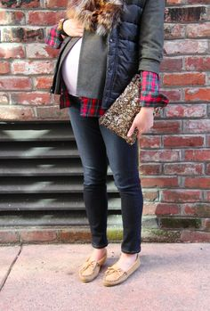 jeans, neutral mocassins, checkered shirt, military jacket, black puffed vest & sequined gold clutch