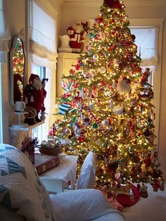We love the way this tree is filled with multicolored, multi-styled ornaments and feels so casual and warm. It's gracious but casual!