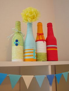 Yarn vases - use plastic bottles and/or non-alcohol ones for maximum kid friendliness
