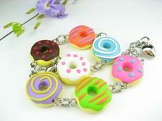 Colorful and fun donut bracelet in dots, stripes and swirls!    Handmade with polymer clay, each donut measures approx 1.8cm wide. Bracelet length is