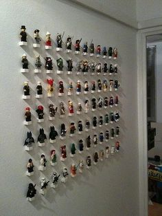 lego minifigures/characters display wall.  brilliant DIY project - I bet I could make this on a board and then hang it...