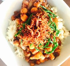 Savoury chana masala served on toasted cumin seed basmati with shredded baby spinach and deep fried grated parsnip