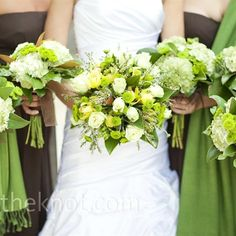 Michelle carried a green, white, and yellow mix of roses, orchids, and tiny kiwi mums.