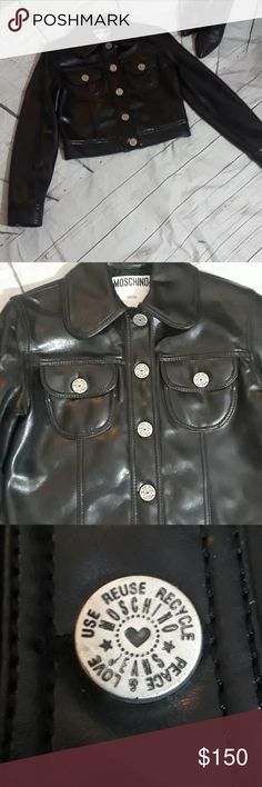 Moschino faux leather moto jacket size 8 Beautiful black moto jacket in great condition. The jacket buttons up with beautiful silver buttons. The jacket sits at the waist. Armpit to armpit the jacket is 19 inches and the length shoulder to waist is 18.5 inches. Moschino Jackets & Coats