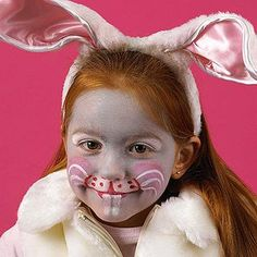 <p>Rabbit ears may be an obvious choice to turn your child into a hoppy bunny, but painting on a nose, whiskers, and teeth pushes the ensemble to a new level of playfulness without the need for excess accessories. Start by sponging on a basecoat of gray and white paint, then simply add rosy cheeks and details around the mouth.</p>