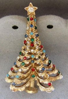 This vintage Boucher Christmas Tree Pin Brooch was designed in the 60's.