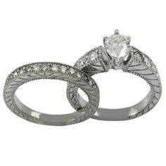 Both the engagement ring and the wedding band have a matching decoration comprised of delicate diagonal lines engraved on either side and brilliant diamond accents covering the half top
