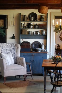 FARMHOUSE – INTERIOR – early american decor inside this vintage farmhouse seems perfect in this country farmhouse.