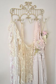 beautiful vintage lace camisoles -- might try this display idea -- or does it just look like new stuff not put away? || #vintage #lace