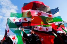 People wave Turkish and Free Syrian Army flags during a gathering before the departure of a Syria-bound aid convoy, carrying humanitarian supplies, in Istanbul, Turkey, December 14, 2016. REUTERS/Murad Sezer