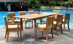 "New 9 Pc Luxurious Grade-A Teak Dining Set - 117"" Double Extension Rectangle Table 8 Arm / Captain Chairs [Model:GVl] by WholesaleTeak. $1949.99. Teak wood is an extremely dense course grained hardwood and is widely known for its durability.. You can lengthen the table with minimal effort by simply opening the butterfly leaf extensions.. Table Dimension: Approx: 82"" L(without extension) and 117"" L(with extension), 42.5"" W , 29.5"" H. ADD SUNBRELLA FABRIC CUSHIONS BY SEARCHING..."