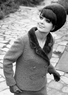 Fashion model from Leipzig, GDR wearing a wool suit trimmed with fur and a matching fur hat, 1966.