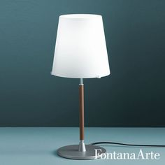 With black power cable, dimmer and plug, FontanaArte 2198TA Table Lamp has Pearwood stem. #FontanaArte #tablelamp #HistoricalArchive Available at allmodernoutlet.com  http://www.allmodernoutlet.com/fontanaarte-2198ta-table-lamp/