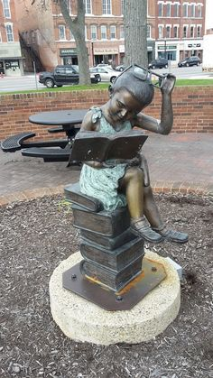 The Little Girl Who Loved To Read  I found this sculpture today while I took some pictures of the Co. Courthouse in Bryan, Ohio ...