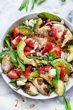 A simple balsamic dressing does double duty as a marinade for the chicken in this light and healthy, fresh spinach, avocado and strawberry salad.