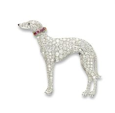 Art deco diamond, ruby and onyx greyhound brooch